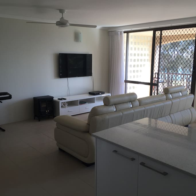 LCD TV with Foxtel, beautiful leather couch and ceiling fan