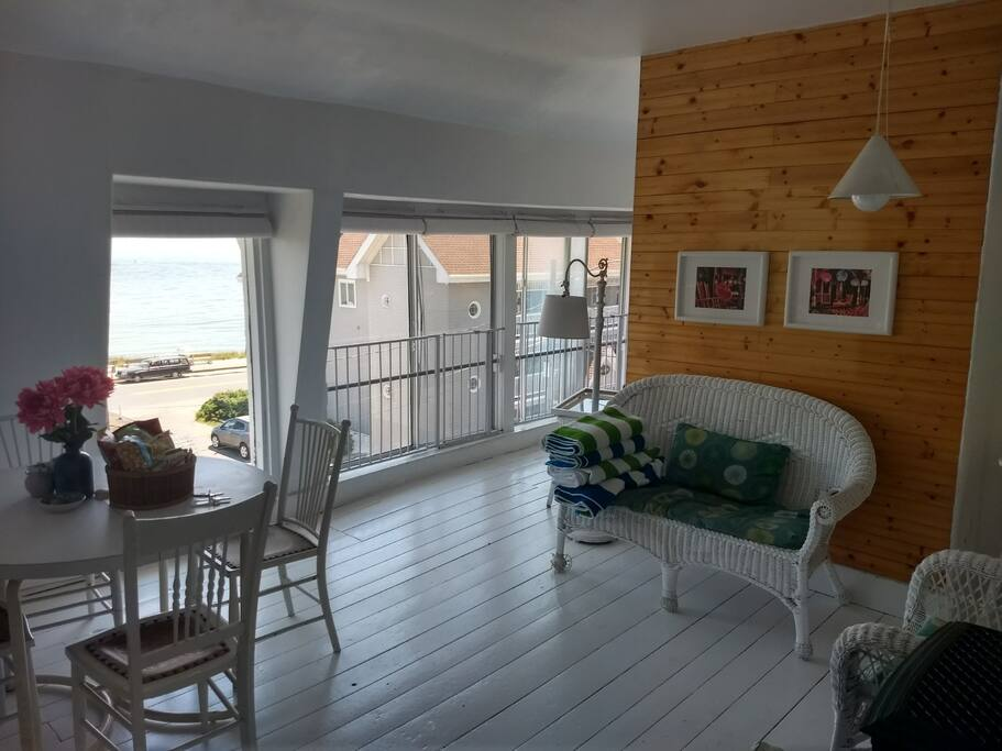 "The living room from the furthest corner. Note the Inkwell is still in view. Many listings on this site claim to be ""steps"" away from the beach. With this view, it looks more like a leap-- Use the stairs, though, please, no matter how strong your superpowers feel on vacation."