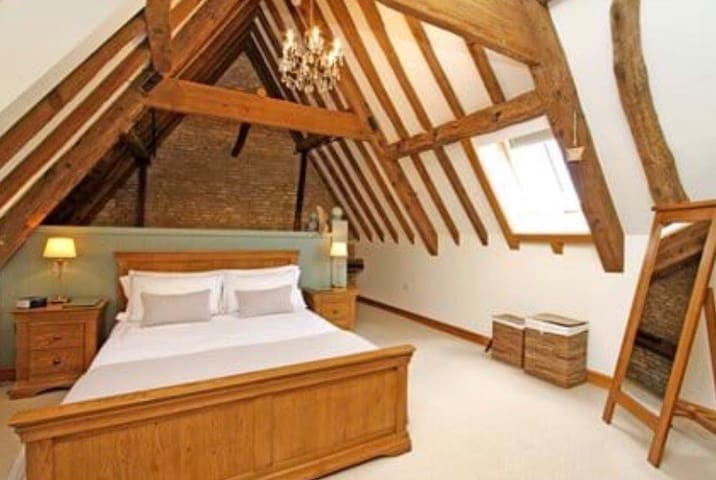 Master Bedroom, with king size sleigh bed dressed with luxury bedding. Plenty of storage including a wardrobe with hangers and large chest of drawers to keep your clothing pristine. Free standing full length mirror and dresser mirror.