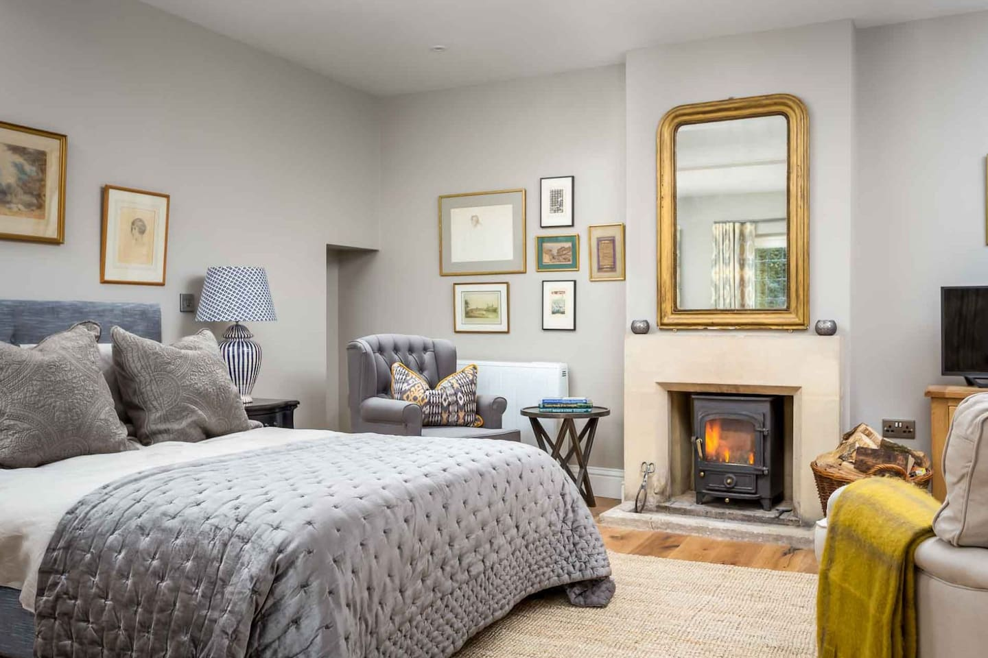 The king size bed is next to the fabulous roaring wood burner
