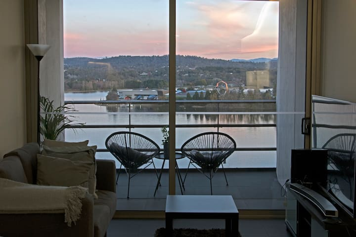 Sky-high, lakeview NewActon unit. Parking included