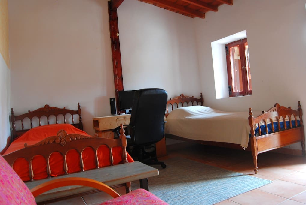 Your room with two single beds. It has private entrance