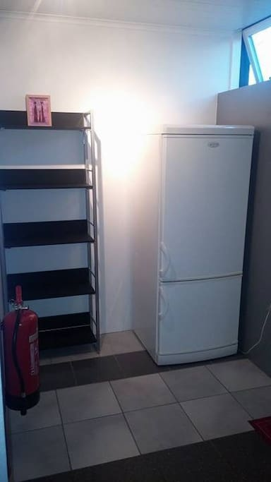 private fridge with a freezer below.