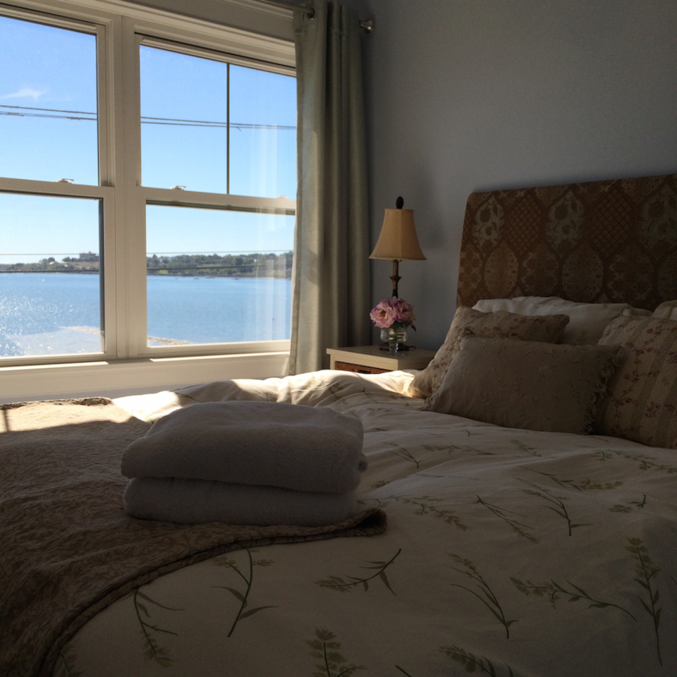 Bedroom with view luxury linens, pillows and bedding.