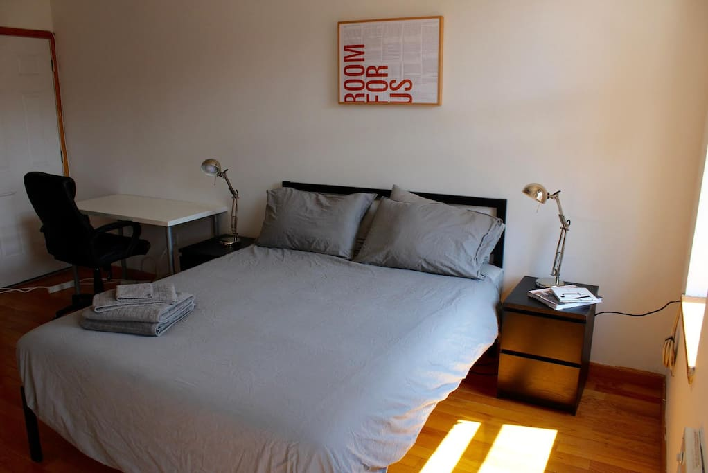 The second bedroom, also with plenty of natural light and a queen sized mattress so you get a good night's sleep after a full day of exploring NYC! This room also has a large desk and chair for the traveler who needs to keep up on emails while enjoying all that NYC has to offer.