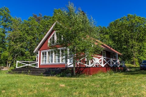 Idyllic summer house with lake view