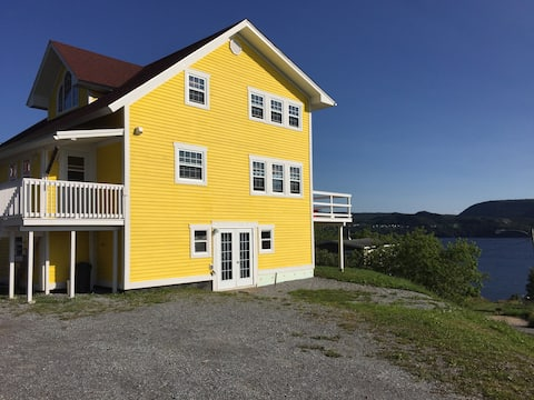 The Bright Yellow House on Meadows Point