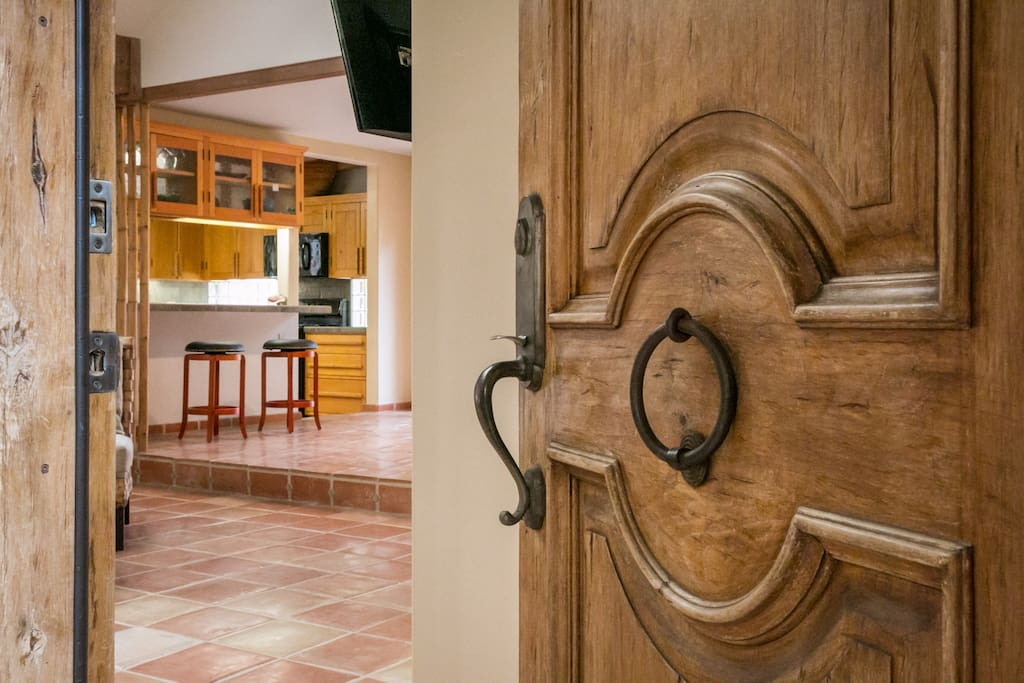 An antique door and rock walls mark the front entrance.