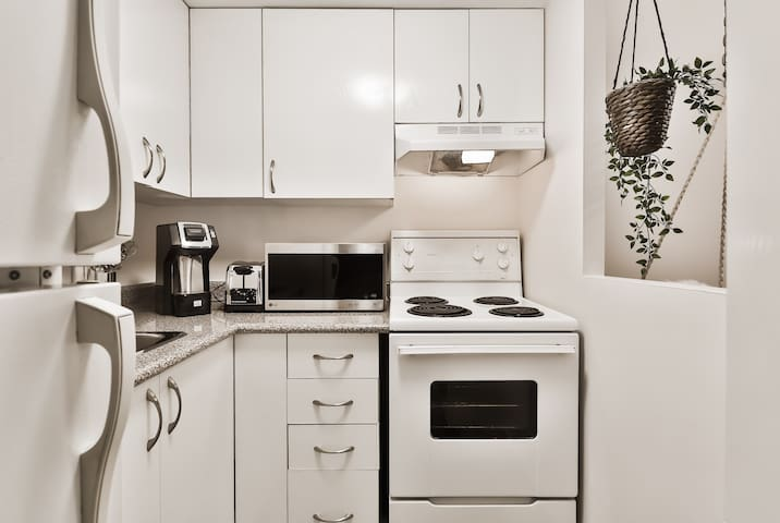 Fully equipped kitchen: Oven,fridge,plates,utensils and pots and pans