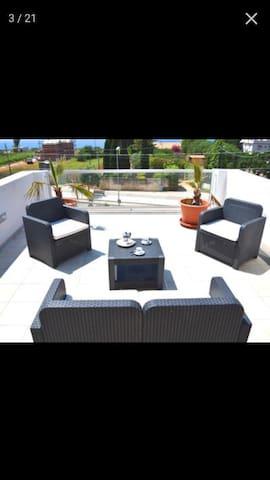 Appartamento con terrazza vista mare - Marinella - Huis