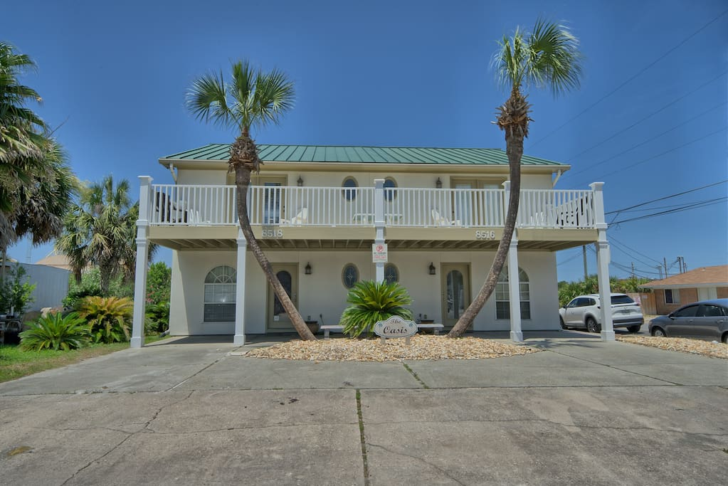 Beautiful home located right across the beach with pool and hot tub.