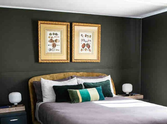 The green bedroom- with a soft and comfy queen mattress