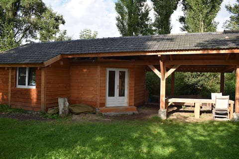 Wooden, romantic chalet at the river the Waal.