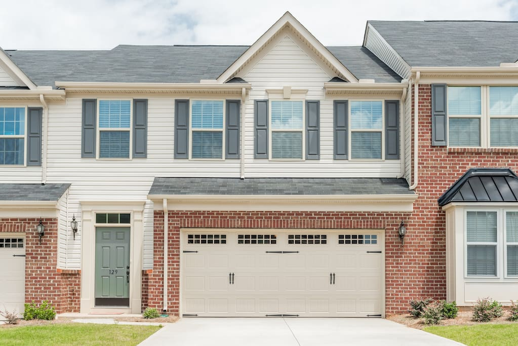 Brand new townhome with covered 2-car garage