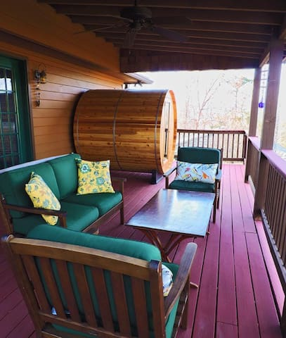 Cedar barrel sauna on guest entrance deck, overlooking the pool.  Outdoor shower to the right of sauna.