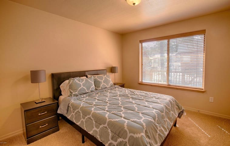 Second bedroom has a queen bed and closet with plenty of windows