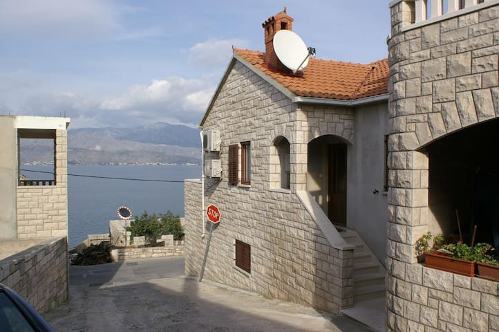 Two bedroom apartment with terrace and sea view Postira, Brač (A-2898-b)