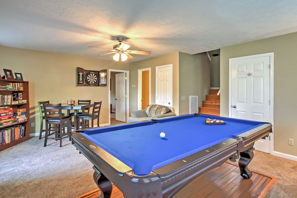Find entertainment in the rec room with pool table, dart board, board games, and books.