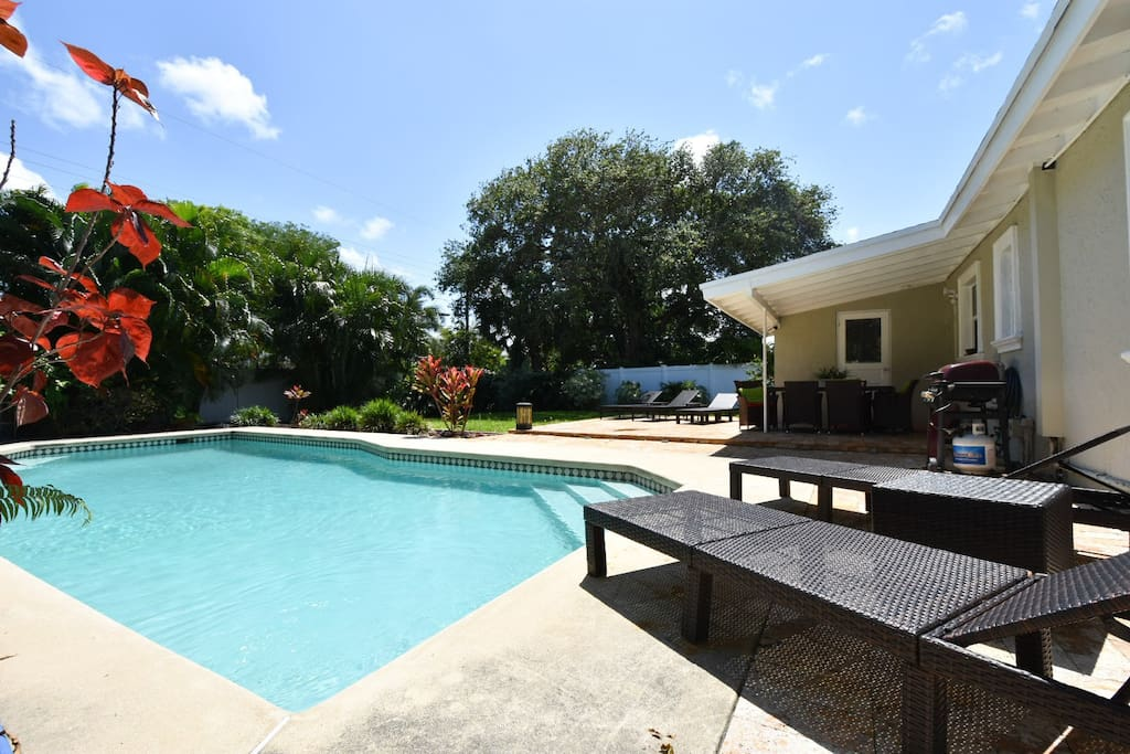 private pool, lounge chairs, covered outdoor dining, beautiful landscaping