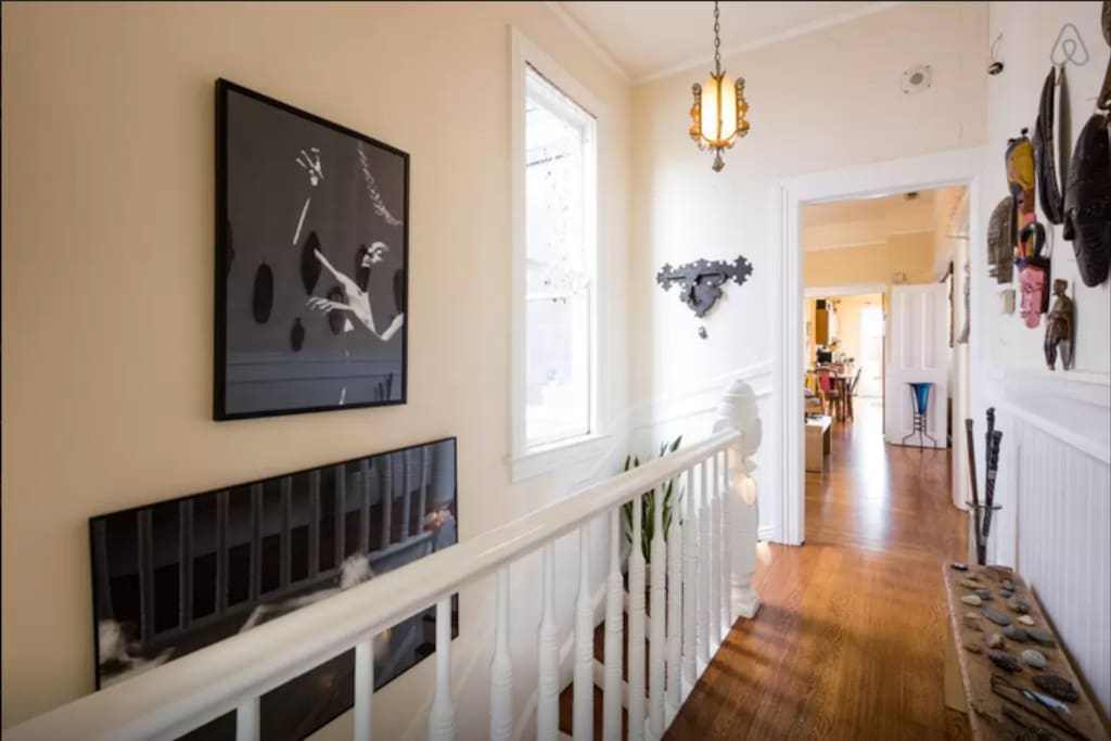 Hallway with plenty of natural light and art