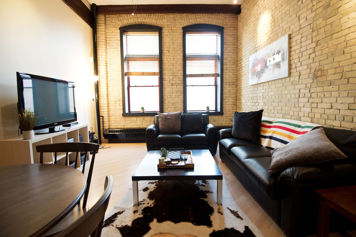 Living area with beautiful exposed brick.