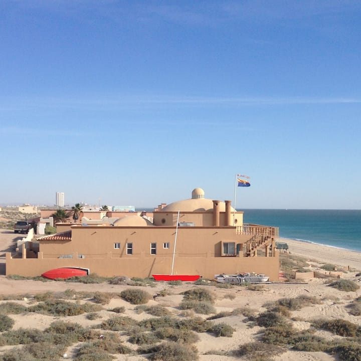 Peaceful Beachfront Dreams starring at blue sea
