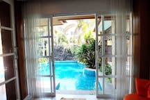 View From Living Room To Outside Private Pool