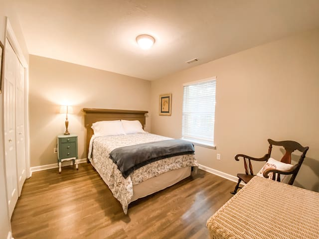 4th bedroom located on bottom floor next to laundry and 1/2 bath. Wall mounted flat screen TV