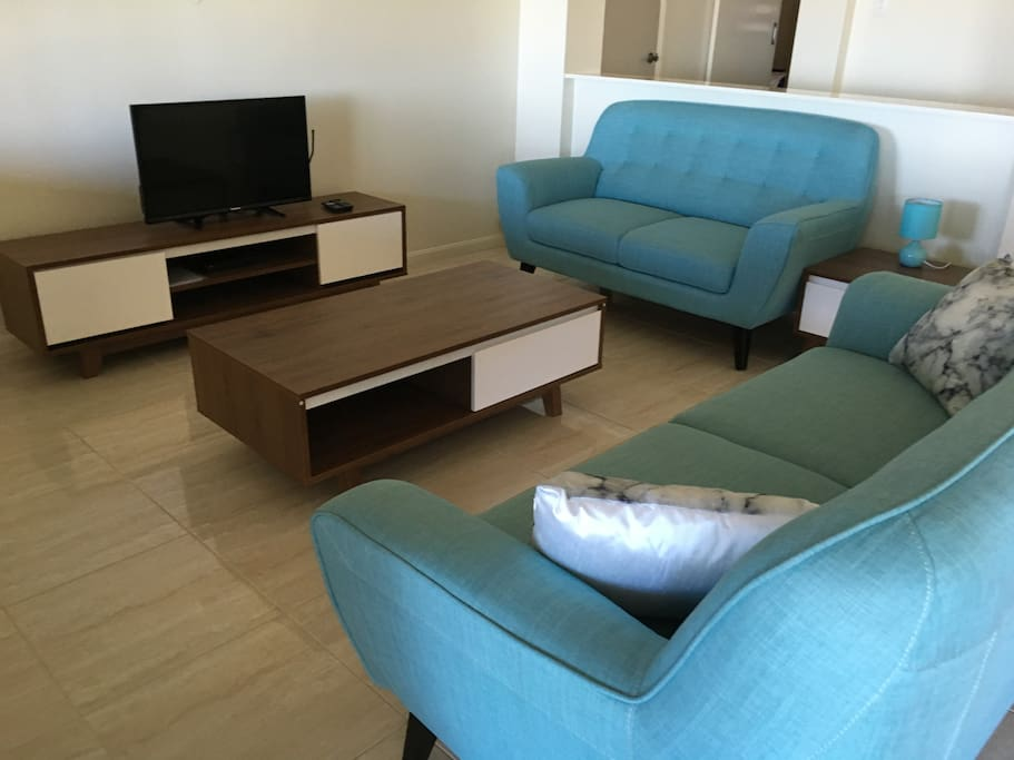 Lounge room- tiled, TV, lounges, dvd, water views, relax