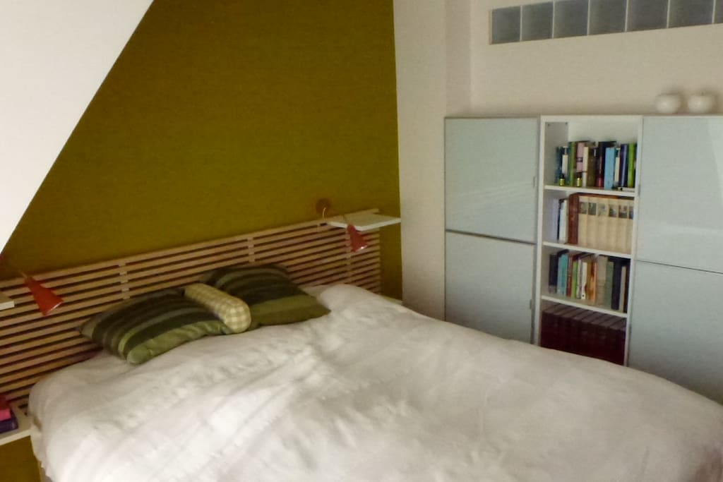 Your room. It's in the 1st flor, quiet, bright, huge terrasse-windows, but you can darken it completely. Very comfortable