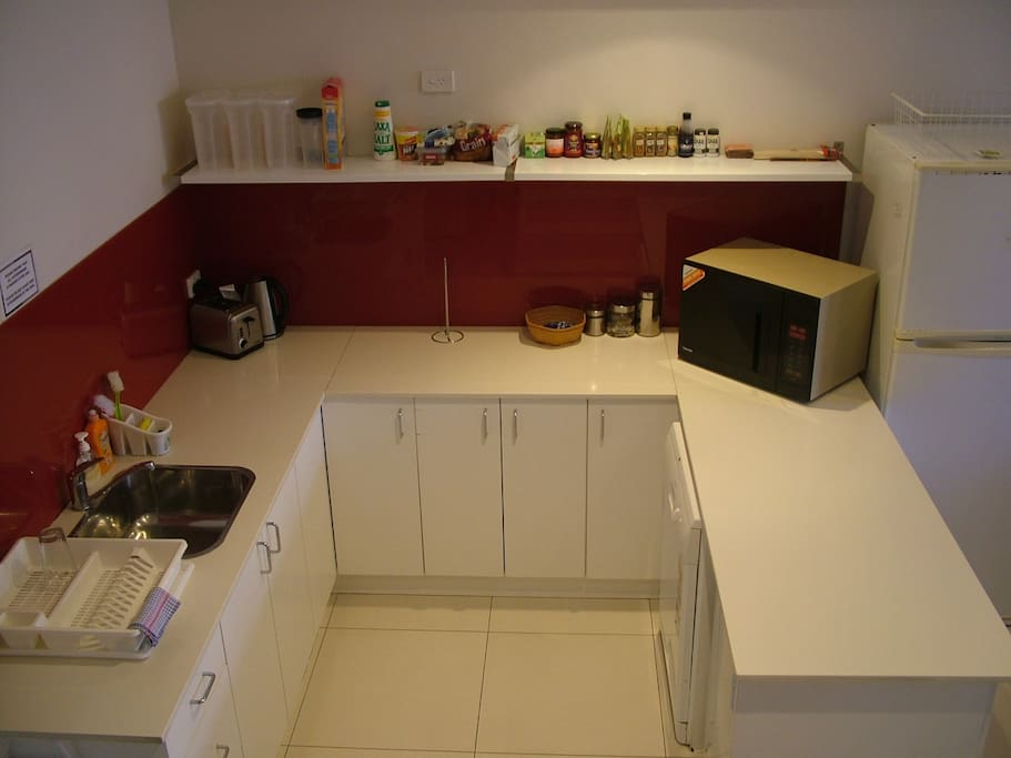 Common kitchen Area with microwave, kettle, toaster, fridges and free tea/coffee