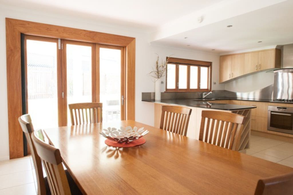 Enjoy meals together at the large dining table.