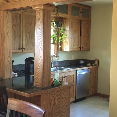 Kitchen with k-cup coffee maker, microwave and stove (shared)