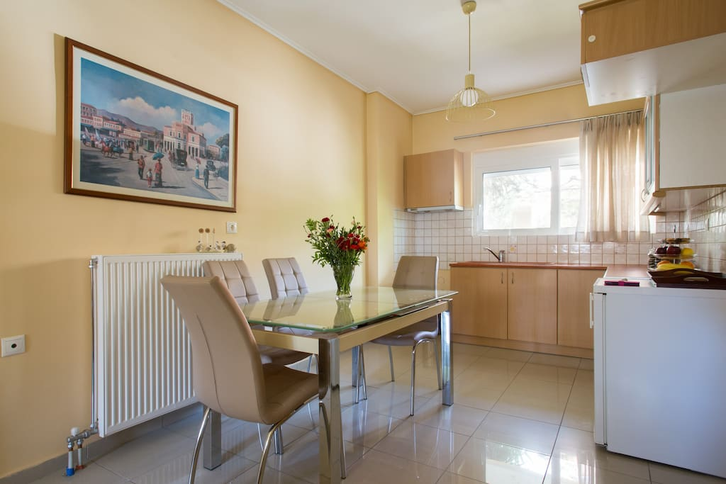 Kitchen and dining area with big dinning table, which can be opened to accommodate up to 8 people.