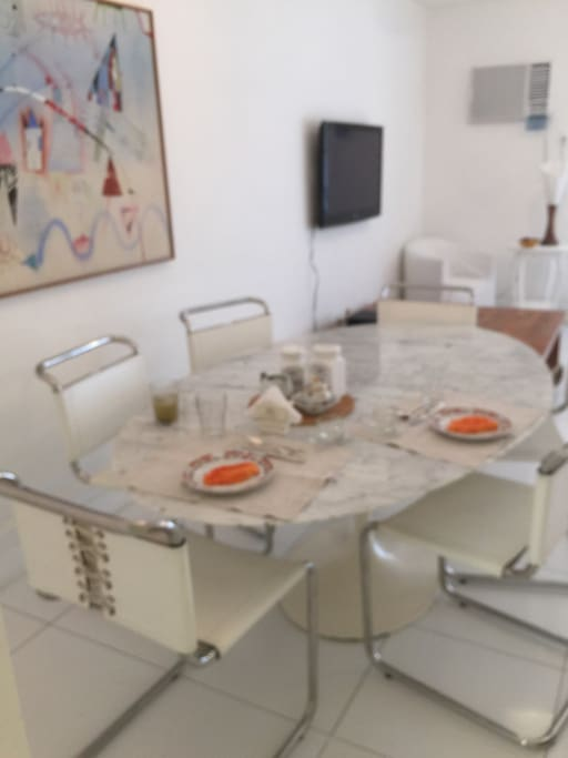 Marble table top with comfortable leather chairs, seats 6 comfortably