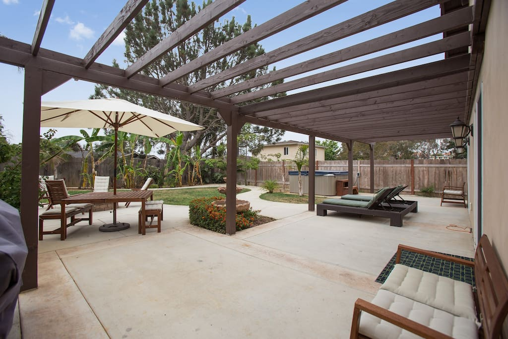 Enjoy the sun or shade and Jacuzzi in this huge back yard!