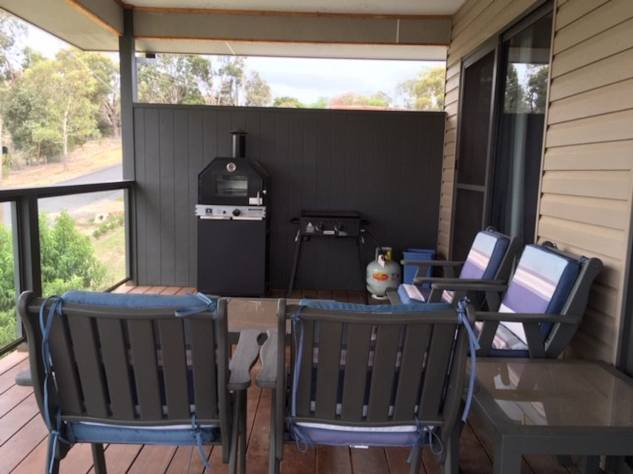 Spacious balcony with views of the Strathbogie ranges. Just relax with a glass of wine and BBQ.