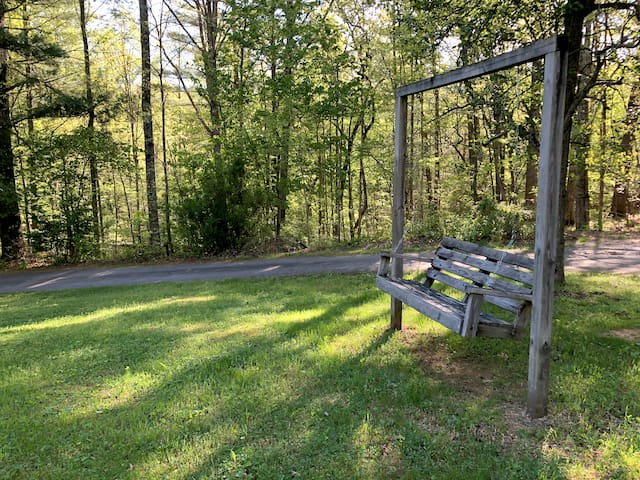Unwind on the outdoor swing and watch fireflies dance across the lawn
