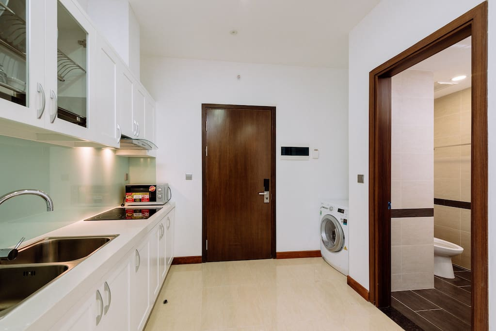 Kitchen area equipped with washer & dryer