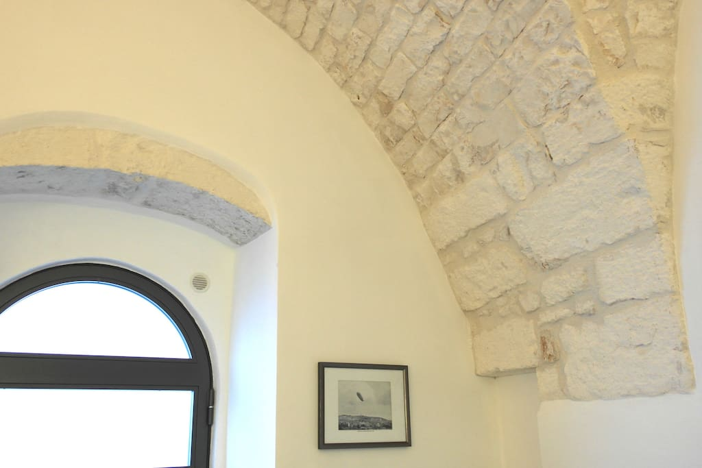 Beautiful exposed stone ceiling by the entrance