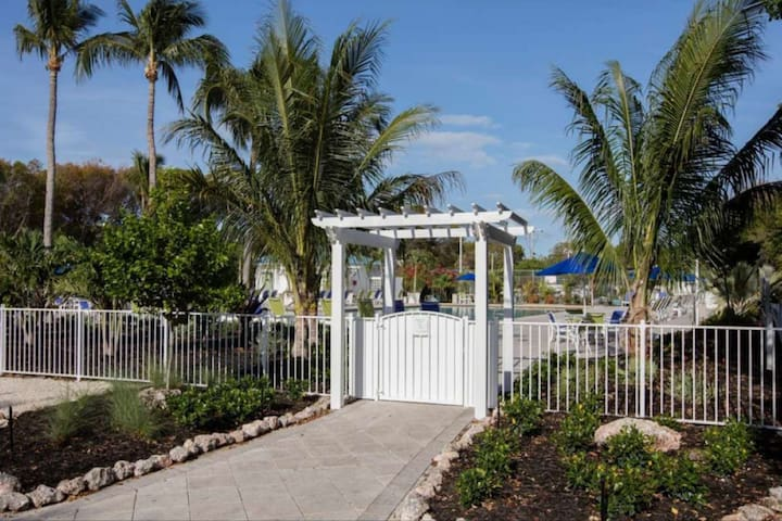 Gated pool area keeps children safely inside or outside of the deck for your convenience.