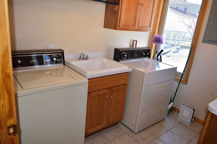 Washer, dryer, and utility sink, laundry soap provided. Basic cleaning products provided.