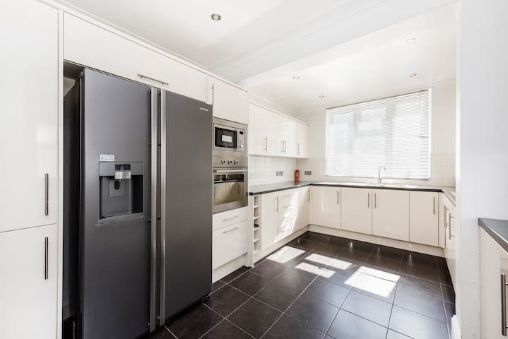 Kitchen with American style fridge freezer, microwave and grill