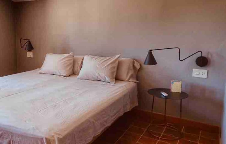 The second bedroom which has a separate entrance with 100% cotton bed sheets and en suite bathroom with high quality towels from Egypt, newly remodeled