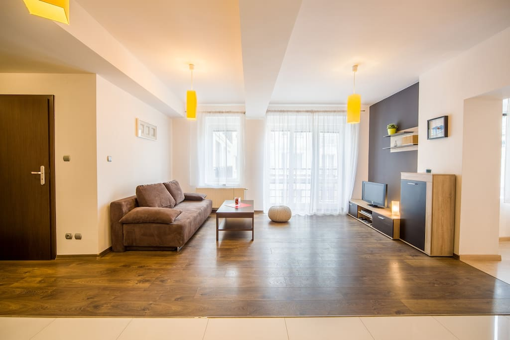 Living Room with Coffee Table, Comfortable Pouf and Flat Screen TV
