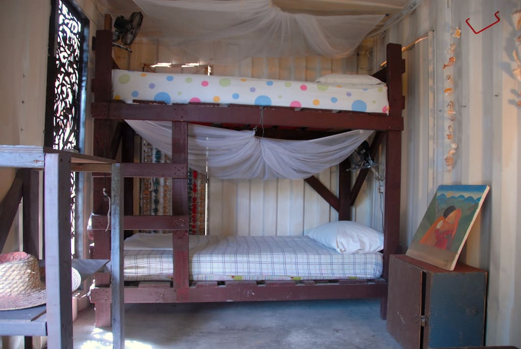 Each bed comes with a fan and a mosquito net as well as storage space. Bring your own lock or rent one upon check-in.