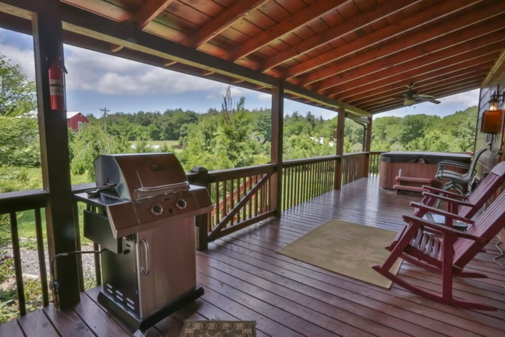 Side covered deck with gas grill and hot tub