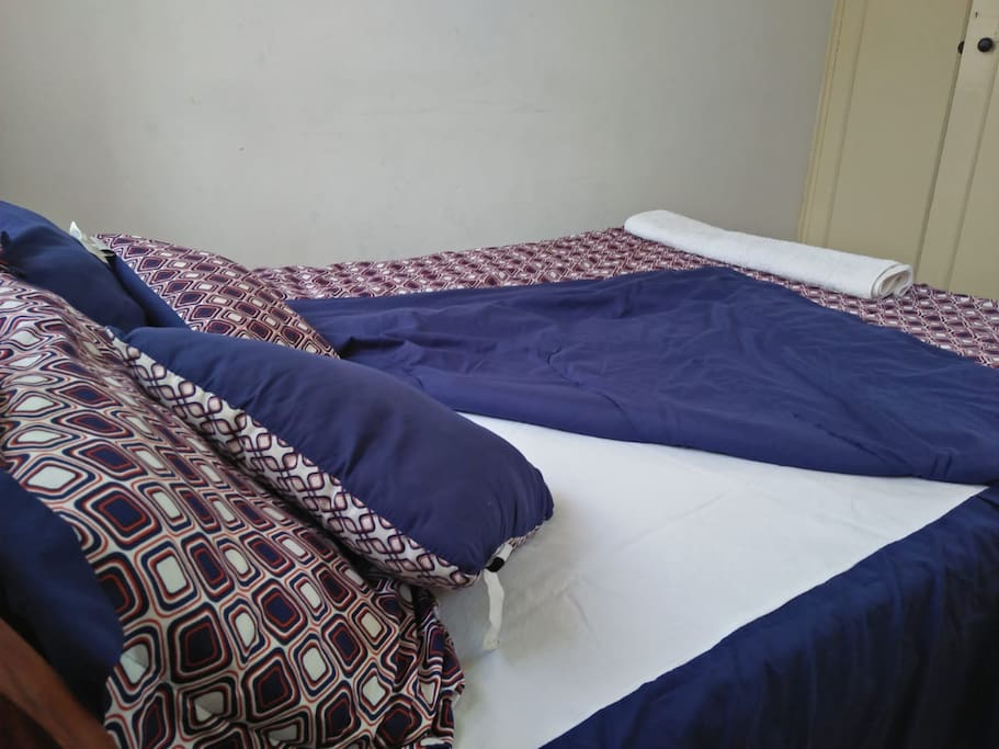 Stylish printed duve on spacious bed with extra pillows for extra comfort