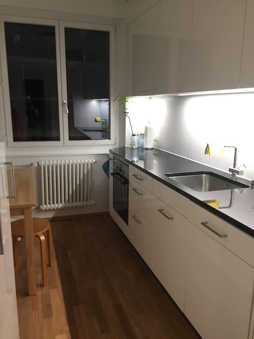 modern kitchen with dishwasher, oven, fridge, toaster, mixer...