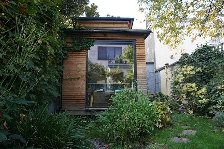 Wooden tiny house in city garden